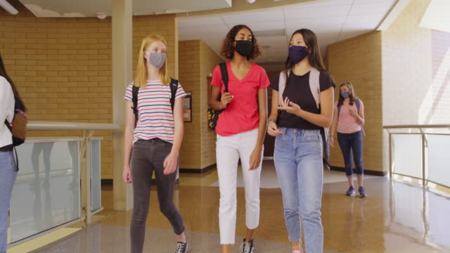 high school students in school wearing protective face mask - back to school stock videos & royalty-free footage