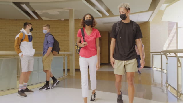 high school students in school wearing protective face mask - teenagers only stock videos & royalty-free footage