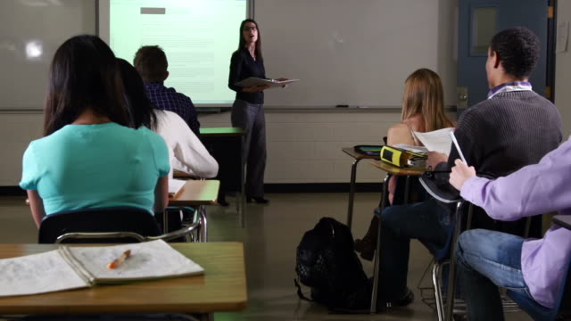high school students learn from teacher and interactive whiteboard. - interactive whiteboard stock videos & royalty-free footage