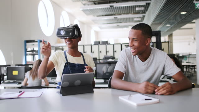 high school students using vr headset in class - secondary school child stock videos & royalty-free footage