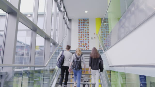 high school students walking on stairs - staircase stock videos & royalty-free footage