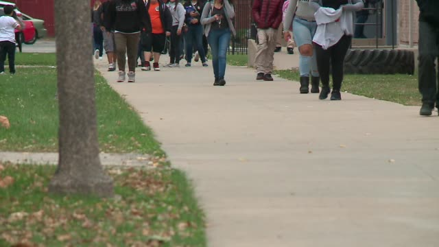 wgn high school students walking to school in chicago on november 9 2015 no faces shown - secondary school child stock videos & royalty-free footage