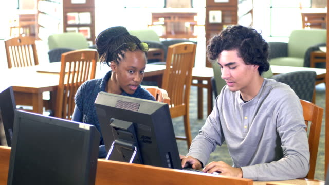 high school students work together on library computers - 16 17 years stock videos & royalty-free footage