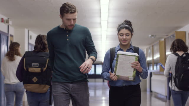 high school teacher and student walking down the hall - locker stock videos and b-roll footage