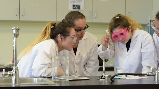 high school teenage girls in science class - scientific experiment stock videos and b-roll footage
