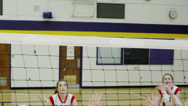 high school volleyball game - female high school student stock videos & royalty-free footage