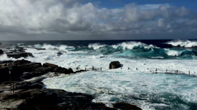 high seas and dangerous surf at rock pool - surf rock stock videos & royalty-free footage
