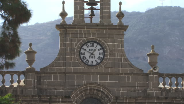 ms, high section of basilica de nuestra senora del pino with clock and bell, teror, gran canaria, canary islands, spain - 17th century style stock videos & royalty-free footage