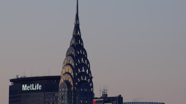 high section of chrysler building and other skyscrapers in new york city. - chrysler building stock-videos und b-roll-filmmaterial