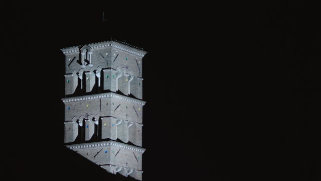ms pan high section view of bell tower at night / rome, italy - bell tower tower stock videos and b-roll footage