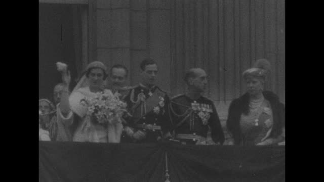 high shot buckingham palace and victoria memorial / prince george, duke of kent, and princess marina, duchess of kent, wave from balcony on their... - king royal person stock videos & royalty-free footage
