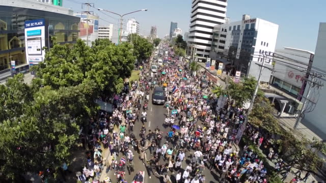 High shot of mass antigovernment protest through the streets of Bangkok on election day