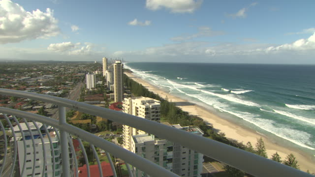 High shot of the Surfers Paradise skyline including buildings and beach taken from balcony of a tall building /various shots of Burleigh Heads Surf...