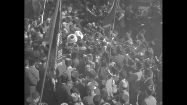 hundreds of men in fez hats packed onto dock, some hold flags, a few toss streamers / vs nationalist army soldiers in formation surrounded by... - turkey middle east stock videos & royalty-free footage