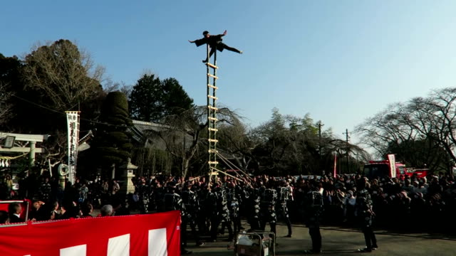 high skills of japan's steeplejacks were displayed on january 4 as young scaffold workers displayed ladder climbing in the coastal area of atomic... - turmarbeiter stock-videos und b-roll-filmmaterial