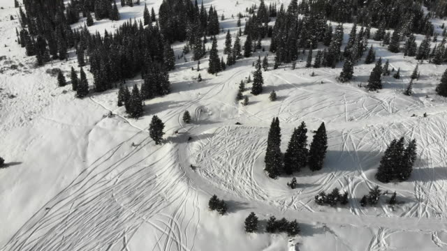 high snow field used for snowmobiling and cross country skiing and other winter sports - snowcapped mountain stock videos & royalty-free footage