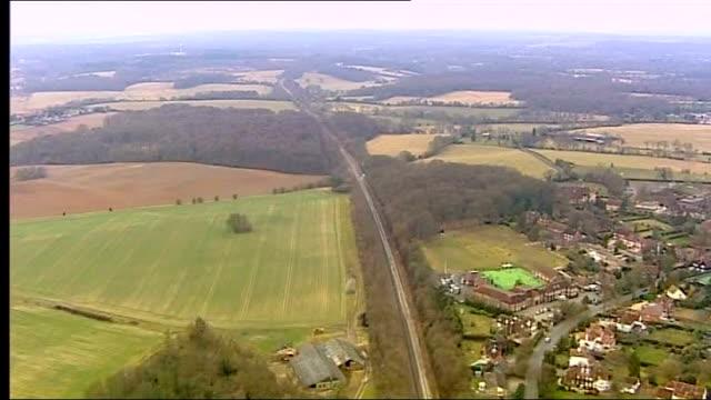 vídeos de stock e filmes b-roll de high speed 2 rail link expected to get go-ahead; air view / aerial over section of proposed route of hs2 - vedação