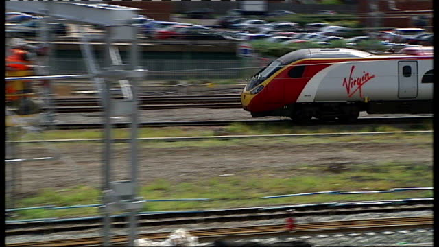 high speed 2 rail link expected to get goahead t23060840 virgin train along section of west coast mainline track past railway workers in foreground... - replacement stock videos & royalty-free footage