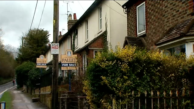 legal challenges thrown out by High Court Traffic along high street Sheila Rankin interview SOT Field at bottom of Sheila Rankin's garden Row of...