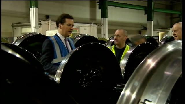 second phase unveiled manchester trafford lucchini uk ltd int various of george osborne mp chatting to train wheel factory workers george osborne mp... - 全部点の映像素材/bロール