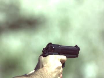 high speed 9mm hand gun - handgun stock videos & royalty-free footage