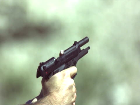 high speed 9mm hand gun - pistolenschießen stock-videos und b-roll-filmmaterial