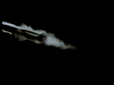 high speed barrel of armelite rifle fires bullet left to right, smoke, black background - bullet stock videos and b-roll footage
