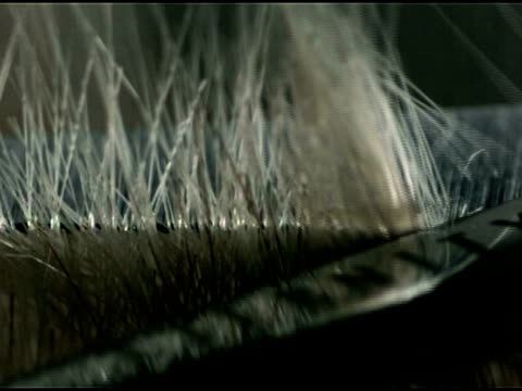 cu high speed blonde hair cutting - cutting hair stock videos and b-roll footage