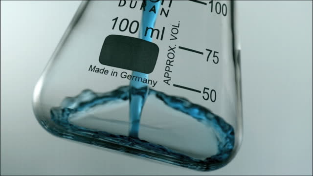 High speed CU blue chemical liquid pouring into glass