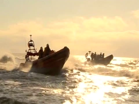 high speed boats carry the olympic torch - flaming torch stock videos & royalty-free footage