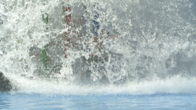 high speed boy running through wall of water, spain. (individual frames may also be used as a still image. each frame in its raw state is about 6mb or about 12mb as a 16 bit tiff) - water slide stock videos & royalty-free footage