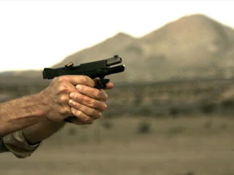 high speed camera - glock 19 pt.iii - gun barrel stock videos & royalty-free footage