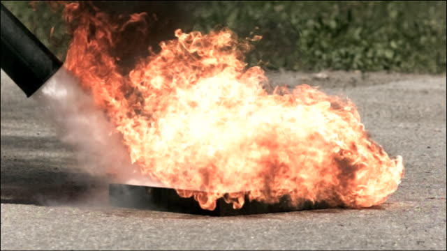 high speed carbon dioxide fire extinguisher, putting out fire - putting stock videos & royalty-free footage