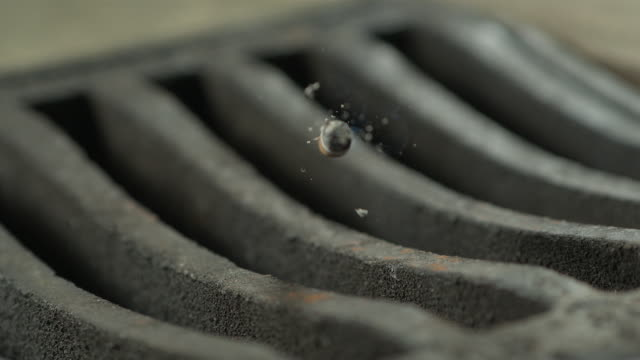 high speed cigarette falling in to drain, close up - zigarette stock-videos und b-roll-filmmaterial