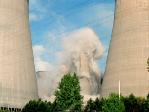 high speed cooling tower demolition, rugeley power station, staffordshire, uk - cooling tower stock videos & royalty-free footage