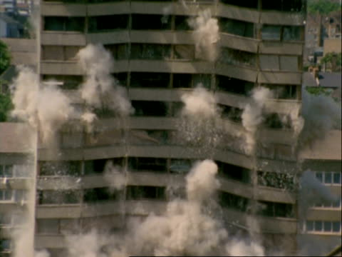 high speed demolition of tower block, mid section, hackney, area of regeneration for the olympics 2012 london, uk - demolishing stock videos & royalty-free footage