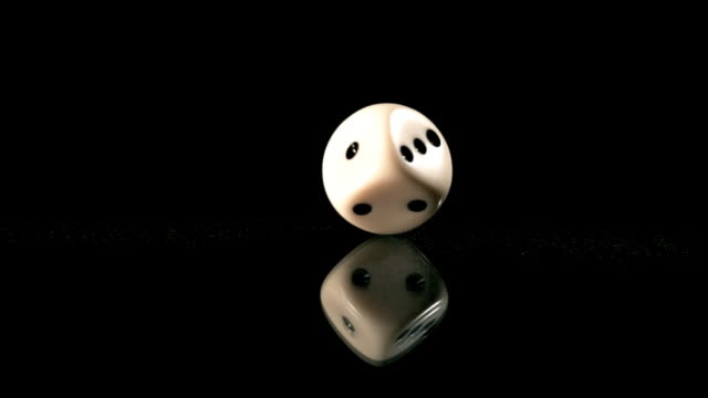 high speed dice rotating on lantern slide - dice stock videos & royalty-free footage
