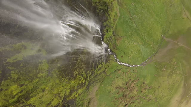 High speed drone flying down waterfall