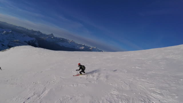 high speed drone flying following downhill skier - downhill skiing stock videos & royalty-free footage