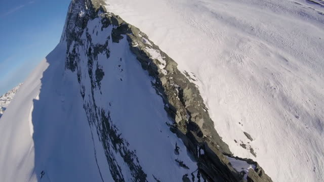 high speed drone flying up knife edge alpine ridge - mountain ridge stock videos & royalty-free footage