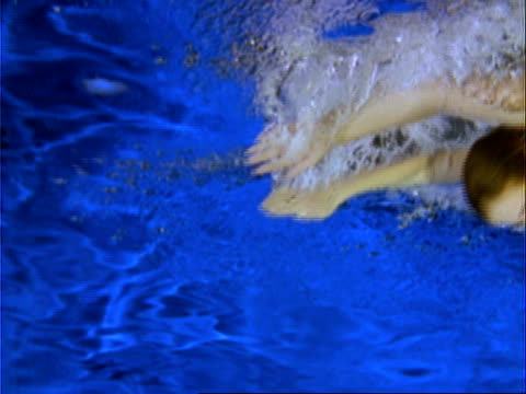 high speed - female swimmer wearing flippers, doing butterfly stroke from right to left, underwater shot - butterfly stroke stock videos and b-roll footage