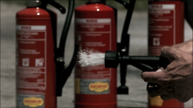 cu high speed fire extinguisher foam nozzle - fire extinguisher stock videos & royalty-free footage