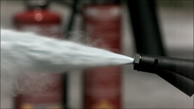 cu high speed fire extinguisher powder nozzle - fire extinguisher stock videos & royalty-free footage
