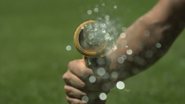 high speed hose spraying water to camera - gärtnern stock-videos und b-roll-filmmaterial