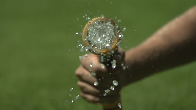 high speed hose spraying water to camera - hose stock videos and b-roll footage