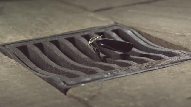 high speed keys falling through drain cover - key stock videos & royalty-free footage