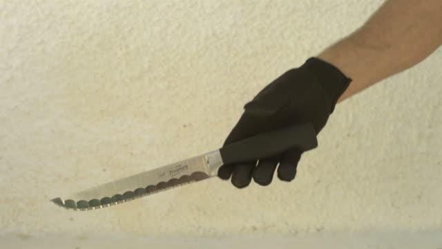 High Speed Knife slips from gloved hand, Spain.