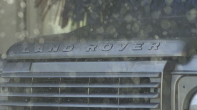 high speed land rover in carwash, close up, spain. - land rover stock videos and b-roll footage