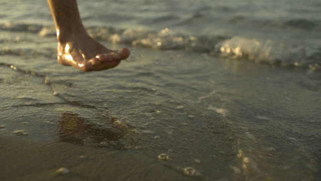high speed man's feet running through sea at dusk, low angle, spain. (individual frames may also be used as a still image. each frame in its raw state is about 6mb or about 12mb as a 16 bit tiff) - human foot stock videos and b-roll footage