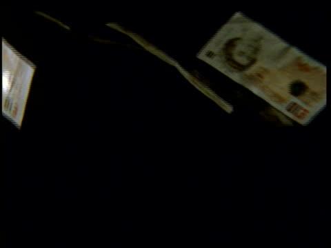 High Speed - Money, #10 bills falling through frame, black background